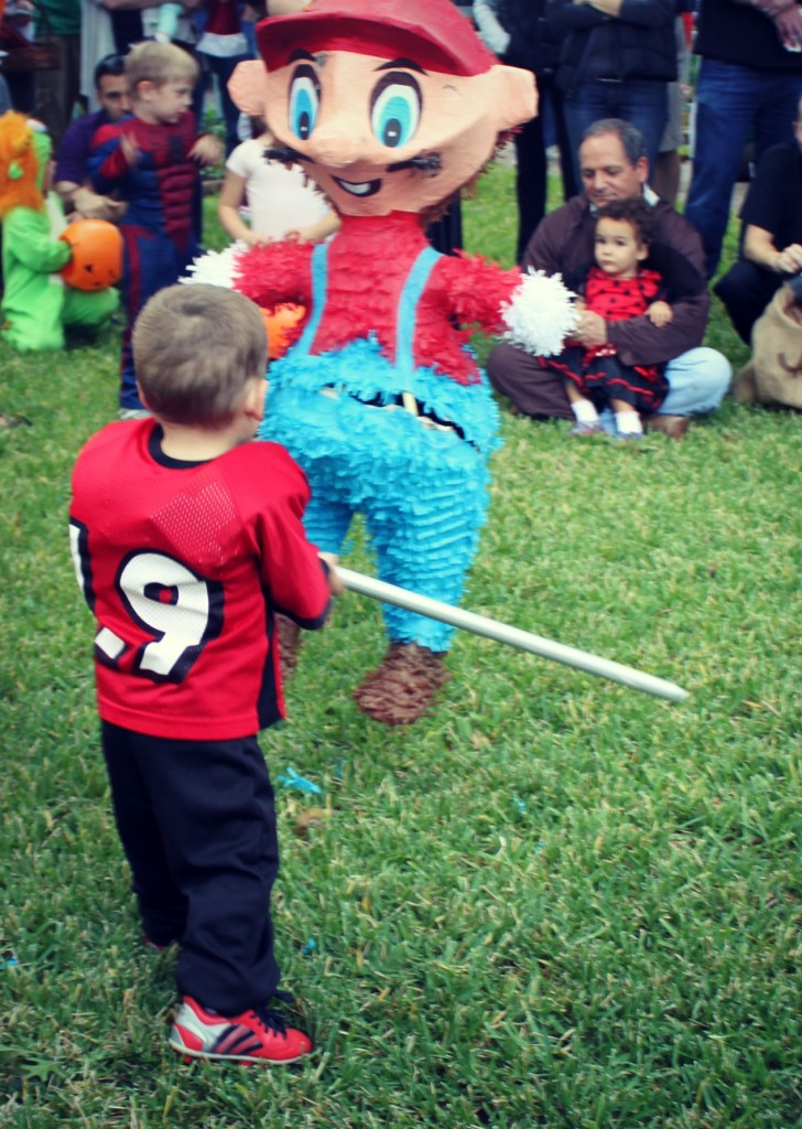 halloween pinata hitting football player