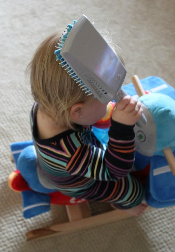 Toddler Mulltitasking - Brushing and Rocking
