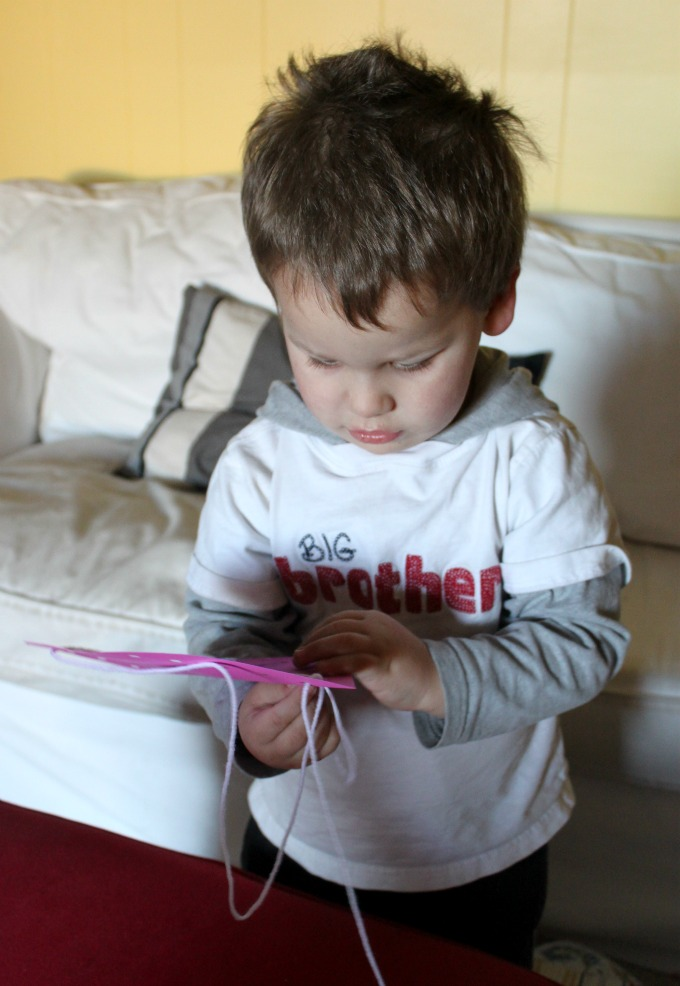 Lacing hearts with preschool kids for Valentine's Day
