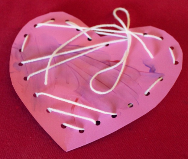 Painting and Lacing Hearts for Preschool Kids Celebrating Valentine's Day