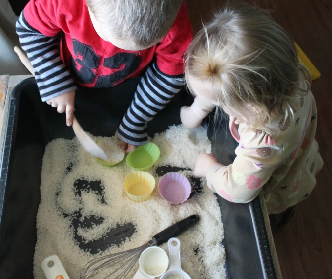 Pretend cooking with a rice sensory bin