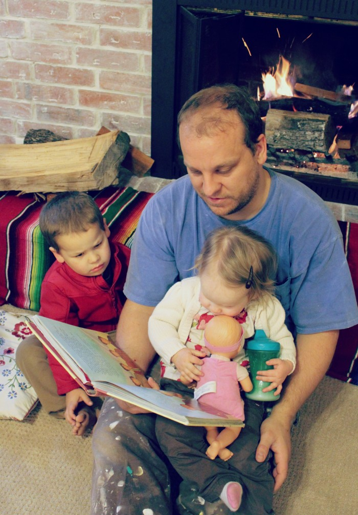 Daddy reading the Jesus Storybook Bible to kids