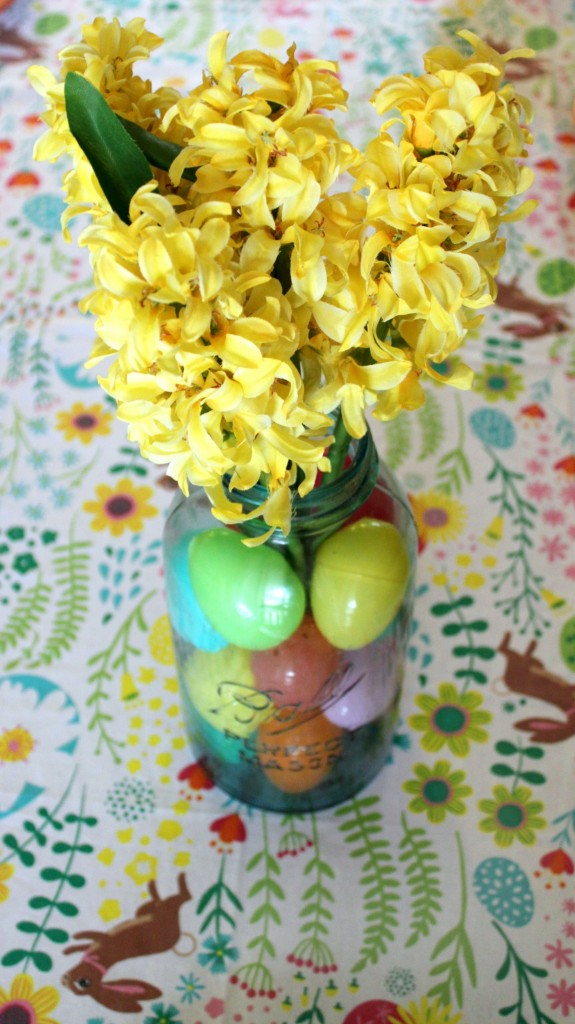 The Easiest Easter Centerpiece Ever - Fill a mason jar with plastic eggs and faux flowers