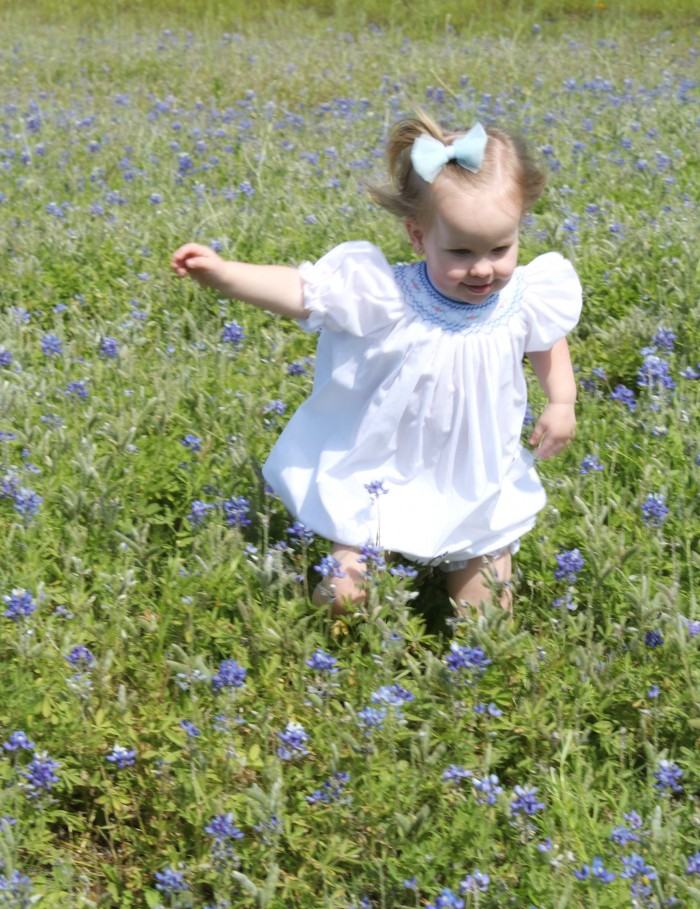 ellie runninng in bluebonnets